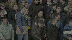 Football fans shout slogans at the stadium Stock Footage