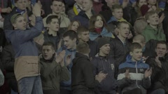 Football fans clapping at the stadium - stock footage