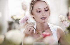 Close up of florist arranging bouquet Stock Photos