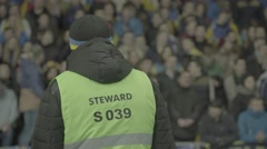 Stuart oversees the behavior of fans ultras in the stadium - stock footage