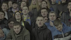 Football fans sing at the stadium - stock footage