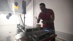 DJ play music with music mixer Stock Footage