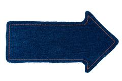 Pointer made of denim fabric with yellow stitching  with space for your text - stock photo