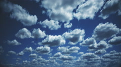 Time lapse clouds travel across a blue sky - Clouds 1534 HD, 4K Stock Footage