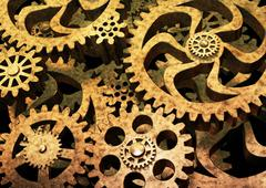 Gears wheels from bronze metal on black background. - stock illustration