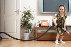 Girl doing housework - stock photo