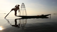 Fisherman on boat catching fish with handmade net . Inle lake, Myanmar - stock footage