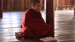 Young monks read mantras in a convent school, Inle lake, Myanmar, Burma Stock Footage