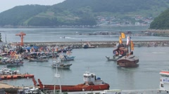 Boats depart from harbor during Hansan festival in Tongyeong, Korea. Stock Footage