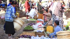 Burmese people buy and sell products on the street food market in Myanmar Stock Footage