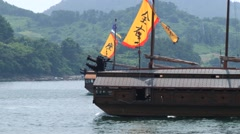 Replicas of the Korean Turtle warship sail in Tongyeong, Korea. Stock Footage
