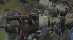 Many photographers take photos during sporting events - stock footage
