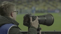 The photographer is watching a football match Stock Footage