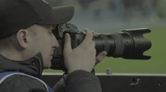 The photographer works at the stadium Stock Footage