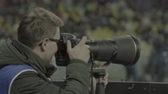 Photographer with a camera taking pictures during the competition Stock Footage