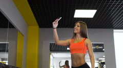 Sport woman smile at camera self picture at gym, young girl picture herself Stock Footage