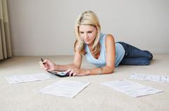 Woman works on home finances - stock photo