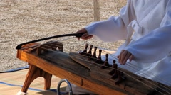 Woman performs music with the traditional Korean musical instrument. - stock footage