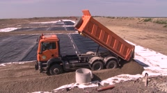 tipper truck dumping ground - stock footage