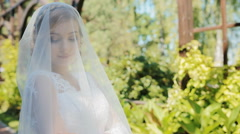 Beautiful bride pose to photographer outdoor Stock Footage