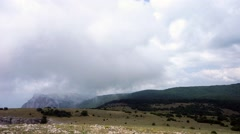 The formation of clouds between the mountains and the sea. Black Sea. Summer - stock footage