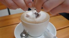 Pour sugar in cappuccino Stock Footage