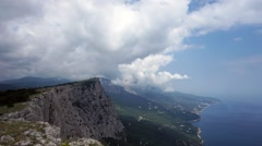 The formation of clouds between the mountains and the sea. Black Sea. Summer Stock Footage