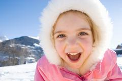 Portrait of young girl in the snow - stock photo