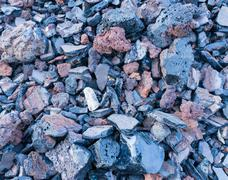 dark texture of burnt coal slag stones. - stock photo