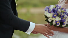 The groom puts the bride's hand forest cones Stock Footage