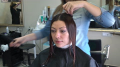 Stylist divides a woman's hair into strands Stock Footage