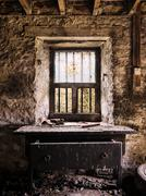 Old work desk with drawer in a derelict, abandoned barn in the Scottish Highland Stock Photos