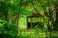 Gazebo in green spring summer garden park - stock photo