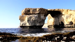 Azure Window, Famous Stone Arch of Gozo Island in the Sun in Summer, Malta. - stock footage