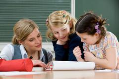 Two girls and teacher Stock Photos