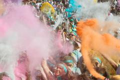 People Create Explosion Of Colors With Colored Corn Starch Packets - stock photo