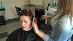 Hairdresser makes hairstyle woman - stock footage