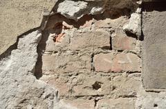 Wall Crack with Brick Surface - stock photo