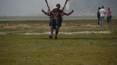 Paragliding tandem landing Stock Footage