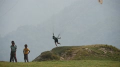 Children and paragliders Stock Footage