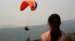 Woman and paraglider Stock Footage