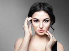 Beautiful Young Woman Touching Her Face Stock Photos