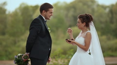 Bride feeds the groom hazelnuts from cones Stock Footage