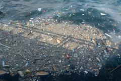 Plastic rubbish pollution in sea Stock Photos