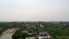 Outskirts of Bangkok viewed from the Airport Rail Link Stock Footage