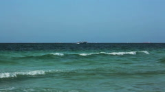 Windy Mediterranean Sea landscape with clear sky and fishing boat in heavy waves Stock Footage