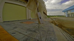 View of abandoned  construction site and electric socket swinging on wire Stock Footage