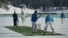 Cricket on ice delivery slow motion Stock Footage