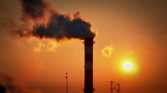 Smoke from chimney at sunrise Stock Footage