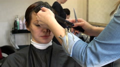 Hairdresser mows bang - stock footage